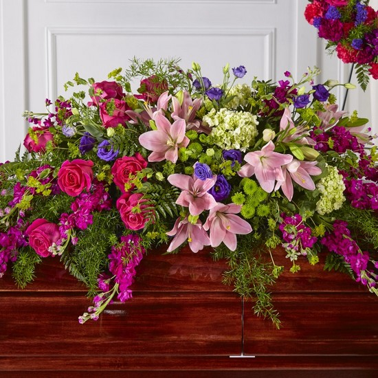 The FTD Radiant Tribute Casket Spray from Dill's Floral Haven, local florist in Belleville, IL